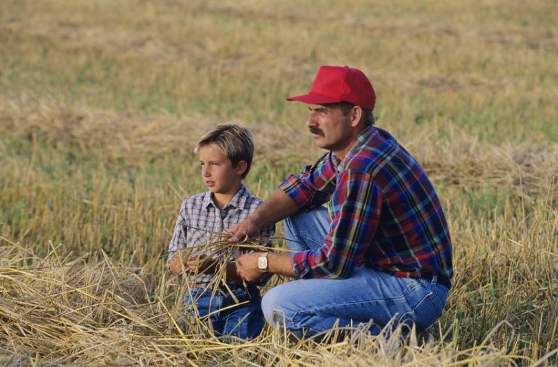 farmer and son in field